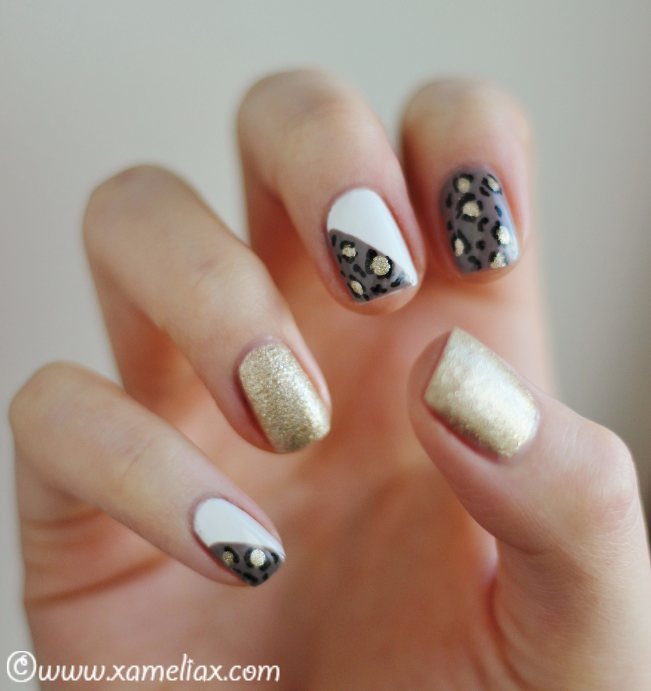 White and Gold Leopard Nails