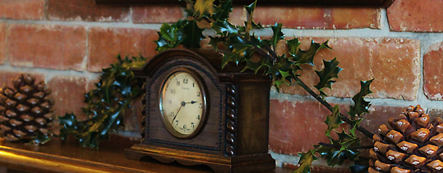 Christmas in Photos, mantelpiece, holly on old fashioned clock
