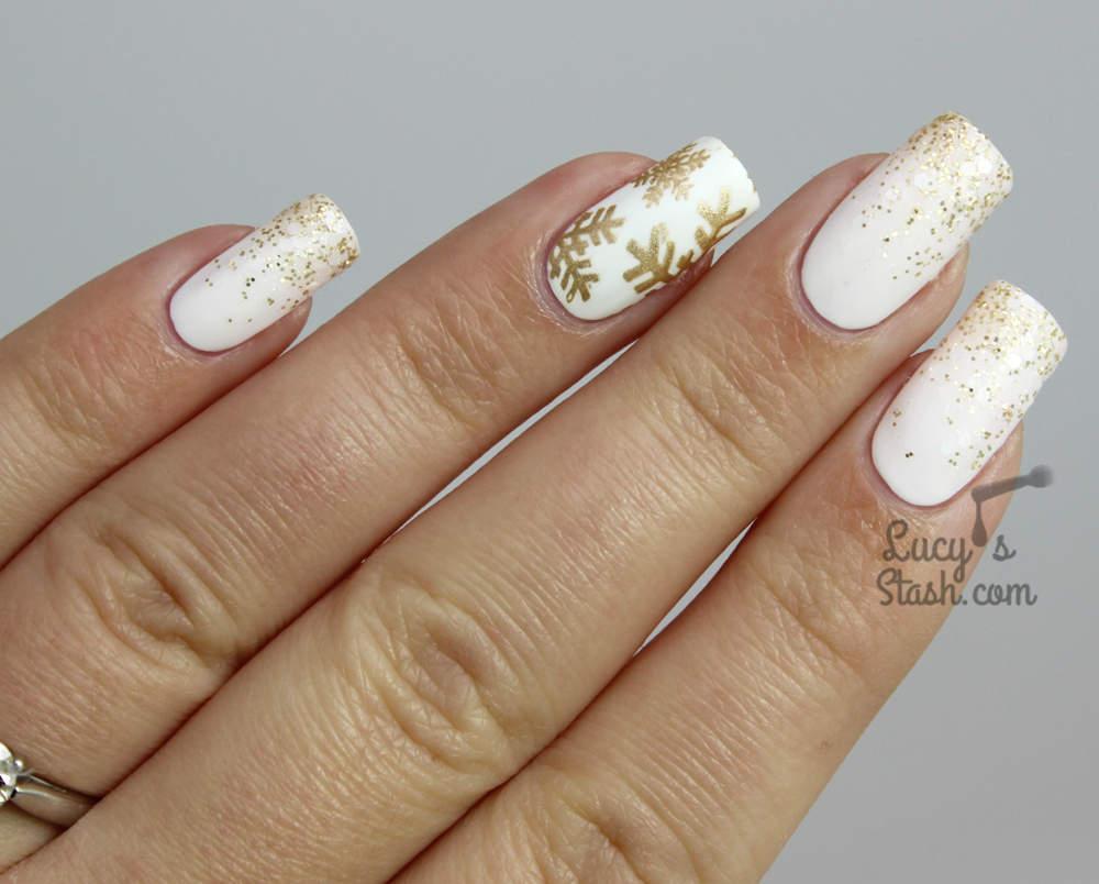ob_f1e274_festive-white-and-gold-snowflake-nails