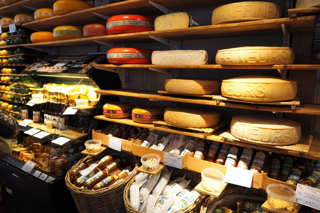 Shelves of cheeses